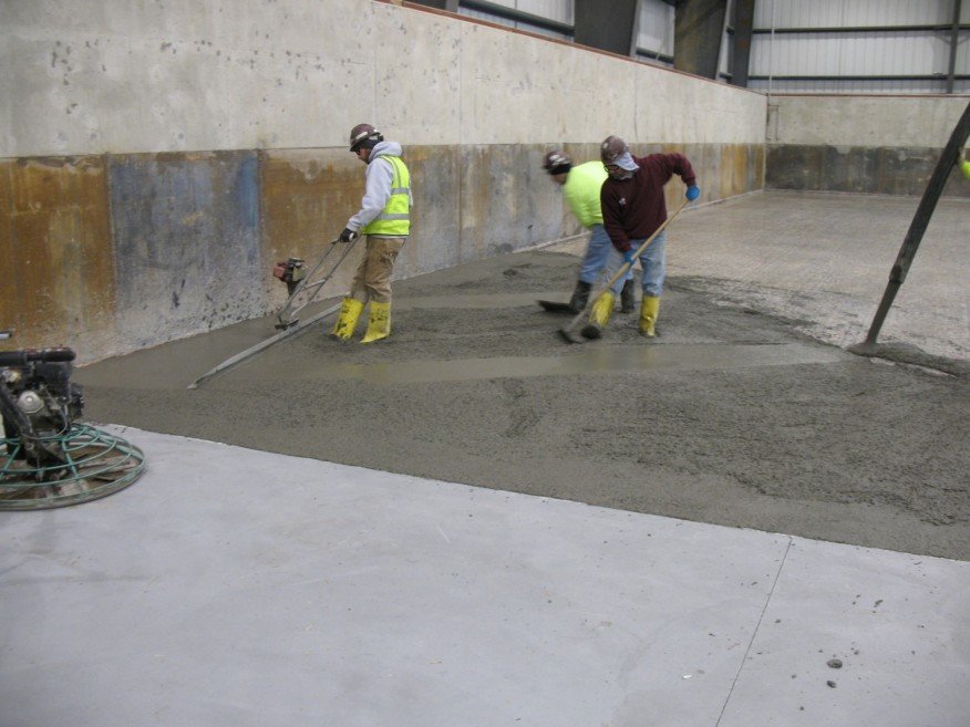 DEALING WITH AMBIENT CONDITIONS WHEN PLACING CONCRETE TOPPINGS (Rain, heat, and cold can all have a negative impact on a topping slab.)